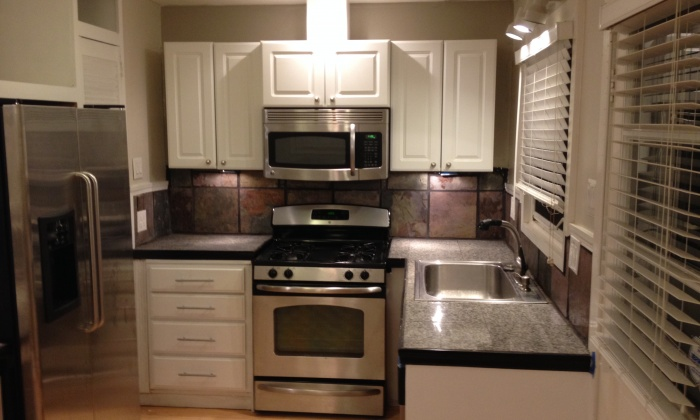 Renovated Kitchen with Granite Countertops, Slate Back Splash, Stainless Steel Appliances, Gas Range, Recessed Lighting