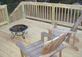 Outdoor Wood Deck leads to Fenced Back Yard